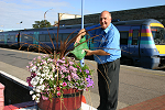A member of the station staff waters the flowers at Lowestoft July 2006