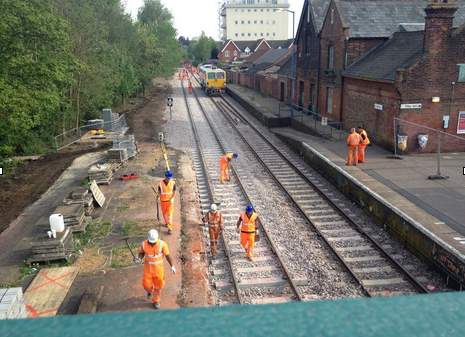 Workers at Beccles station along the newly installed loop