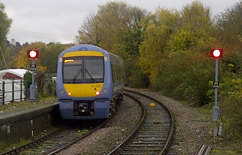 An Ipswich-bound train passes the new signals at Woodbridge station