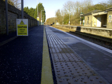 New pavement and textured surface on platforms at Darsham station