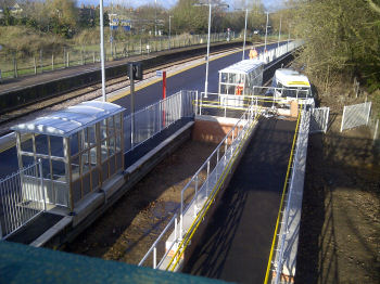 New walkway from the existing footbridge to the restored platform