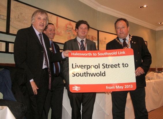 Officials from Greater Anglia and Anglian Bus present the new Southwold bus-rail ticket to the Mayor of Southwold