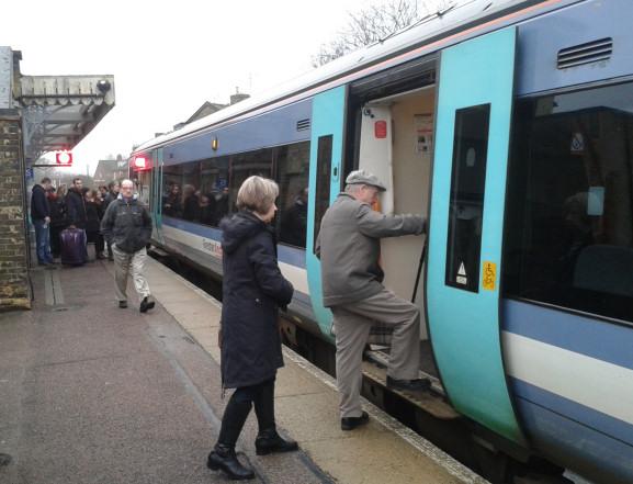 Passengers board an Ipswich bound service at Saxmundham