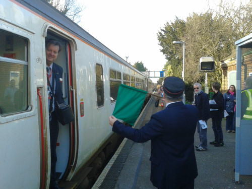 Trust member Colin D'Eath ceremoniously waves off the 14:28 service to Ipswich