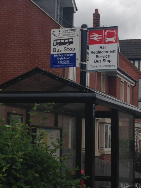 Rail replacement flag for Trimley Station at the bus shelter on High Road (photo courtesy Andrew Gee, Suffolk County Council Passenger Transport)