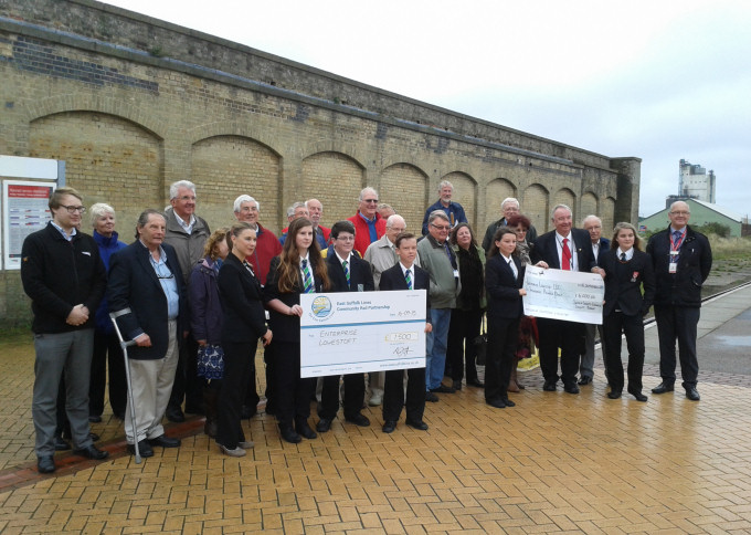 Members of Enterprise Lowestoft, officials from Suffolk County Council, Waveney District Council, Abellio Greater Anglia, and Network Rail join students in a cheque presentation ceremony to officially launch the Lowestoft Station Arches scheme 16 September 2015
