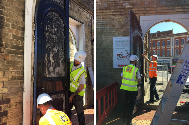 Workers remove the old wooden doors at the eastern end of the concourse at Lowestoft station
