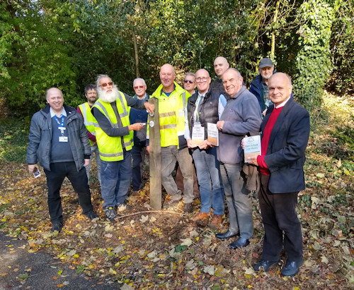 Volunteers from Holywells Park along with members from Ipswich Borough Council, the East Suffolk Lines Community Rail Partnership and the Association of Community Rail Partnerships (ACoRP) at the final post connecting two new station-to-station walking routes