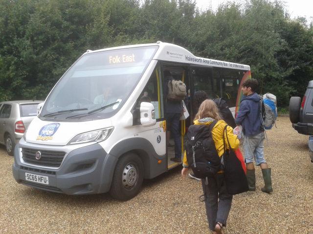 Festival goers board the Folk East shuttle bus at Wickham Market station