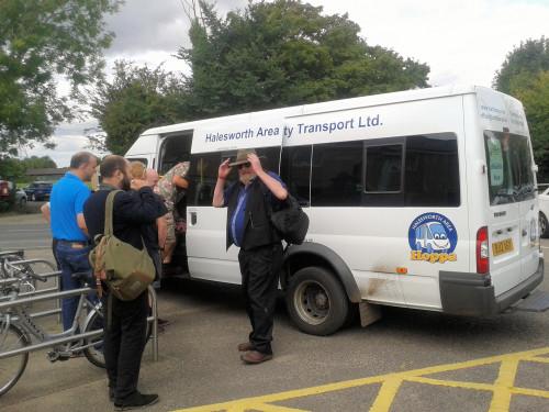 Festival goers board the Folk East bus at Wickham Market station in 2017