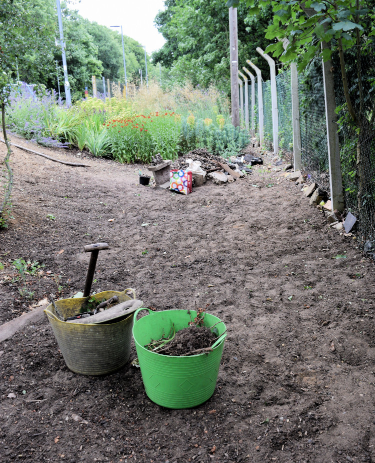 An area at Westerfield station adjacent to the platform cleared for planting