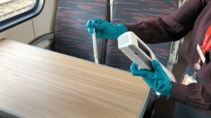 Hygiene monitor being used to test surfaces on a Greater Anglia train